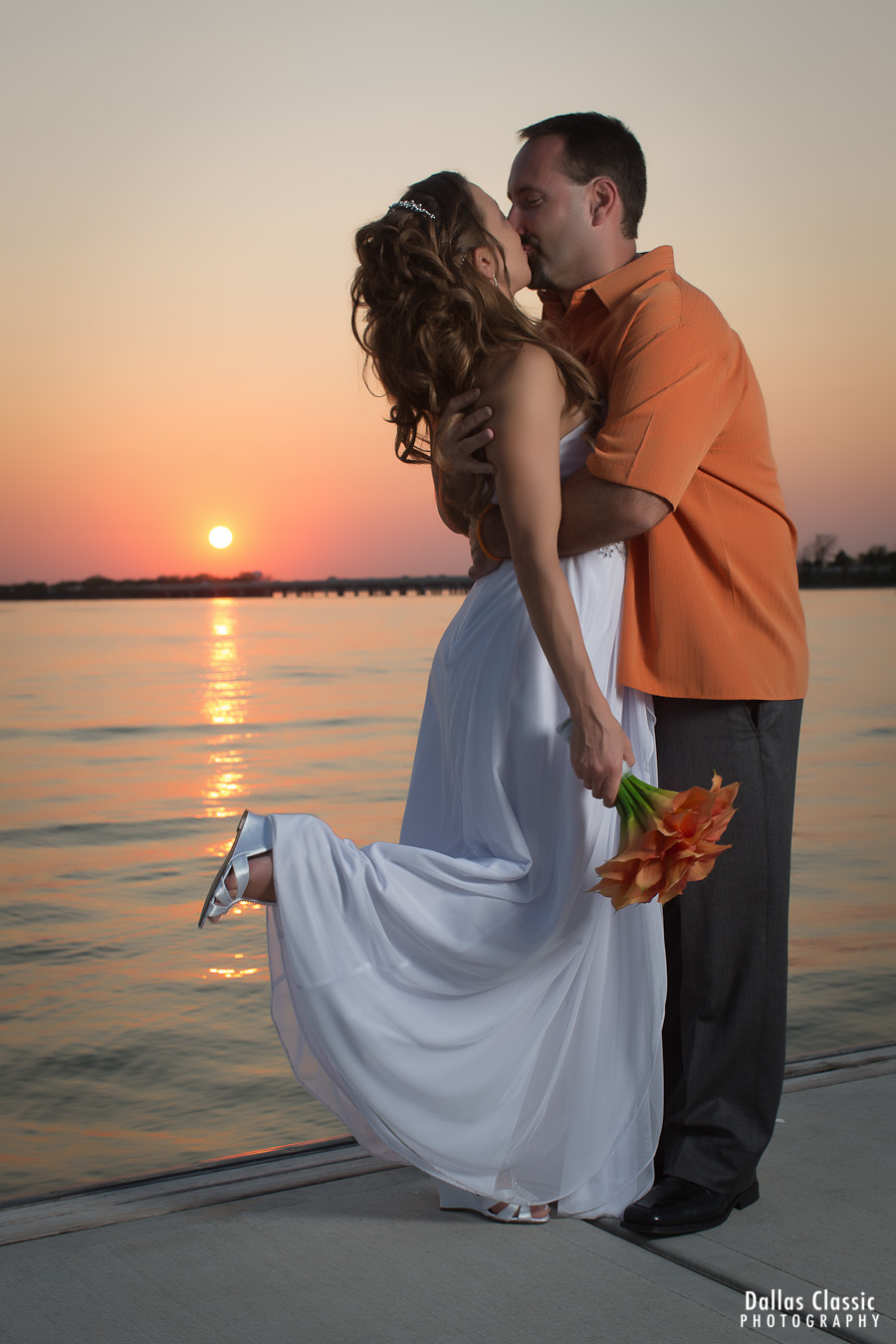 wedding kiss after the reception in dallas